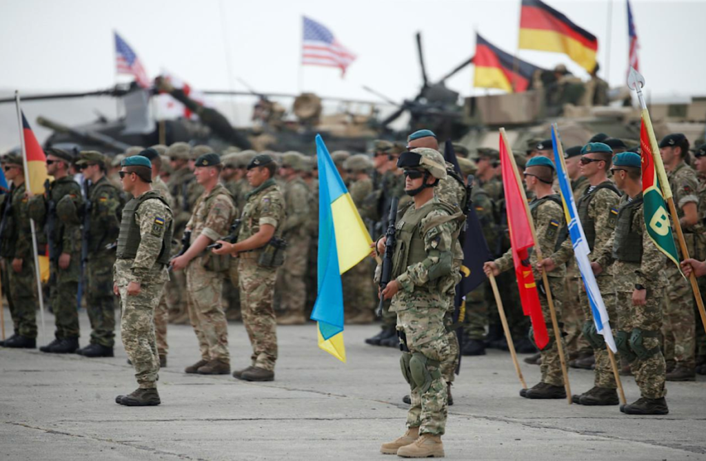 A group of soldiers marching with flags Description automatically generated with medium confidence